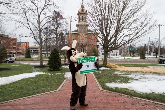 Odie arrived on the Square in Chardon and held up his sign.